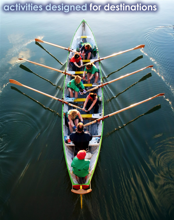 Photo of a team rowing in a boat.