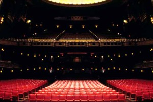 Photo of a large theatre prior to a show. Image Credit: Bahman Farzad, via Flickr/CC.