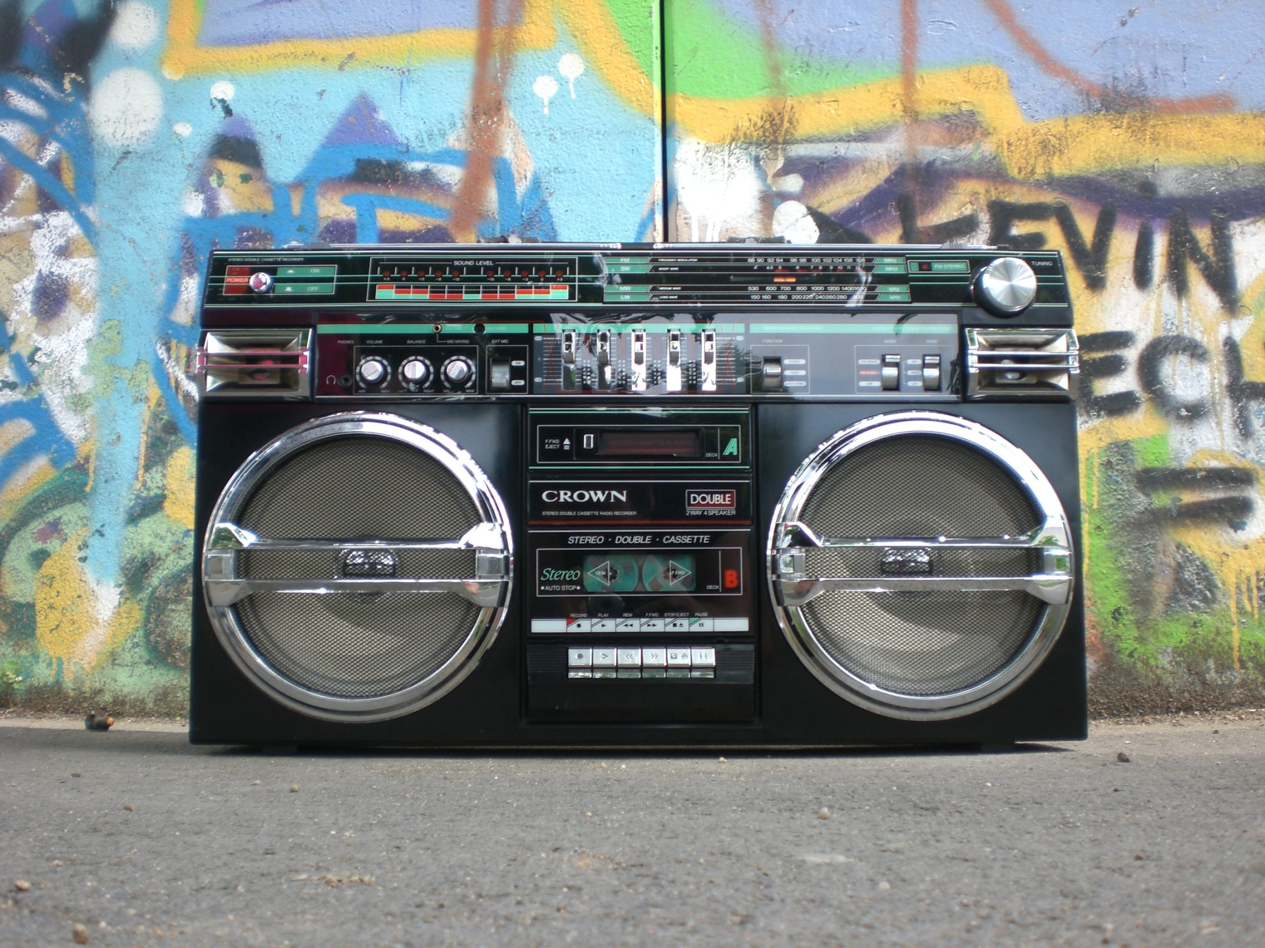 Photo of black and silver cassette player.