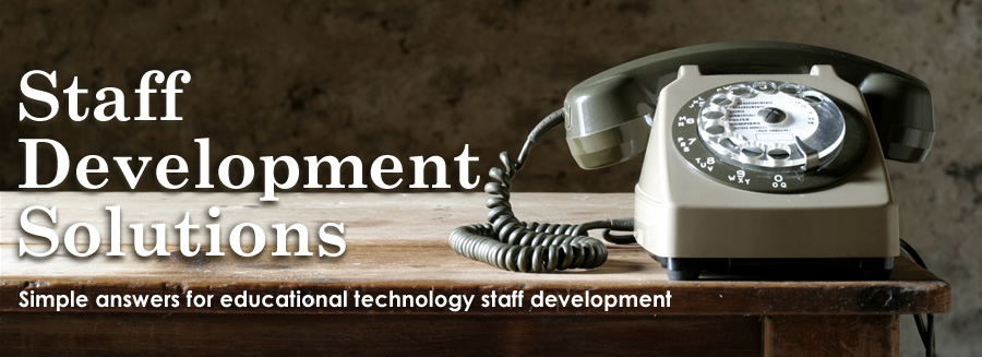 "Photo of a phone with the headline ""Staff Development Solutions."""