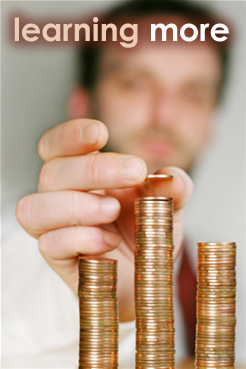 Photo of a man stacking pennies.