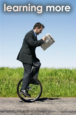 Photo of a man riding a unicycle.