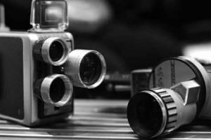 Photograph of vintage handheld video cameras.
