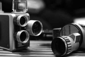 Photograph of vintage handheld video cameras.